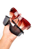 Sunglasses in hand Stock Photos