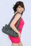 With sunglasses and handbag Stock Photography