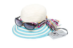 Sunglasses, hat and compact camera Royalty Free Stock Images
