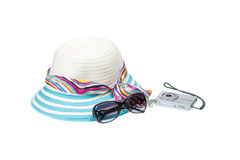 Sunglasses, hat and compact camera Stock Photos