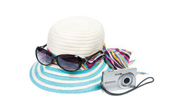 Sunglasses, hat and compact camera Royalty Free Stock Photo