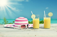 Sunglasses, hat and orange juice Stock Images