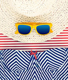 Sunglasses on Hat with Striped Shorts Still Life Stock Photo