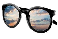 Sunglasses have a sunrise sky reflecting on  isolated  backgroun Stock Image
