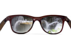 Sunglasses have a waterfall reflecting Royalty Free Stock Photos