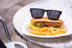 Sunglasses on Hot dog  with french fries. closeup American style. Sauce tomato fried background healthy white cheese bread breakfast bun cuisine curly delicious stock photo
