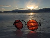 Sunglasses on ice Royalty Free Stock Images