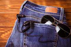 Sunglasses on jean pants retro vintage style Royalty Free Stock Images