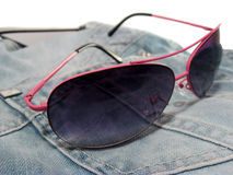 Sunglasses and jeans Stock Photography