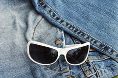 Sunglasses, jeans, pocket Stock Image