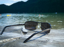 Sunglasses by the lake Royalty Free Stock Photos