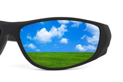 Sunglasses and landscape reflection Stock Photos