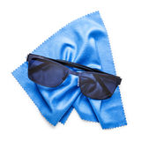 Sunglasses and lens cloth Stock Photo