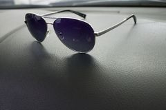 Sunglasses lie in car stock images