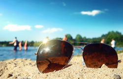 Sunglasses. Lies an sand beach Royalty Free Stock Photography