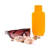 Sunglasses and lotion Stock Photos