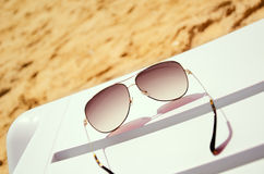 Sunglasses on a lounger Stock Photos