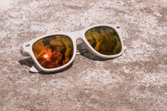 Sunglasses lying on a stone surface texture royalty free stock images