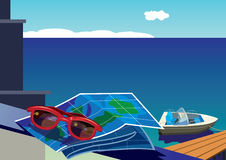 Sunglasses and map on the background of the sea and sailboat Royalty Free Stock Photo