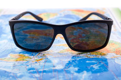 Sunglasses and map Royalty Free Stock Image