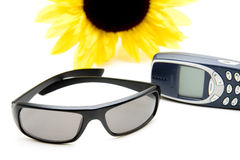 Sunglasses and mobile. Plastic sunglasses and mobile with sunflower Royalty Free Stock Images