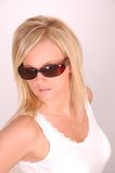 Sunglasses model. Young blonde woman shows sunglasses and acts cool while looking at camera stock photos