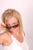 Sunglasses model. Young blonde woman with sunglasses wearing white shirt looks at camera with pretty eyes Stock Photos