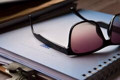 Sunglasses on notebook Stock Image