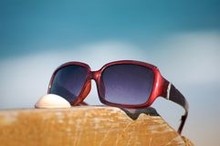 Sunglasses by the ocean Royalty Free Stock Photo