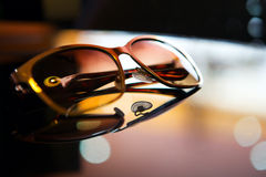 Free Sunglasses On The Table Stock Photos - 38749063