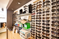 Sunglasses in optician shop Stock Image