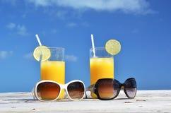 Sunglasses and orange juice Stock Photo