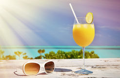 Sunglasses and orange juice Royalty Free Stock Photo