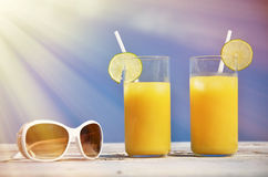 Sunglasses and orange juice Royalty Free Stock Images