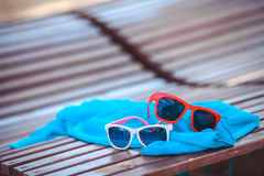 Sunglasses over the beach background Stock Photography
