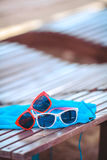 Sunglasses over the beach background Stock Images