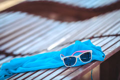 Sunglasses over the beach background Royalty Free Stock Image