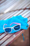 Sunglasses over the beach background Royalty Free Stock Images