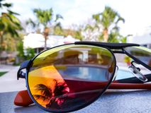 Reflection in sunglasses in a beach stock photography