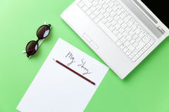 Sunglasses and paper with notebook Royalty Free Stock Photo