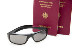 Sunglasses and passport. Plastic sunglasses and passport for the vacation royalty free stock photography