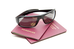 Sunglasses and passport. Plastic sunglasses and passport for the vacation stock photo