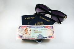 Sunglasses and Passports. Sunglasses Two Passports and Money Stock Photo