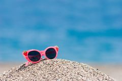 Sunglasses on pebbles Stock Image