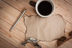 Sunglasses,pen,watch and cup coffee Royalty Free Stock Images