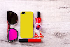 Sunglasses and phone near cosmetics. Royalty Free Stock Images
