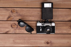 Sunglasses and photo camera Stock Image