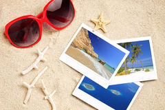 A sunglasses, photos, starfish and corals Royalty Free Stock Images