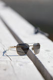 Sunglasses on a pier.GN. Sunglasses laying on a wooden pier on a summer day.GN stock image