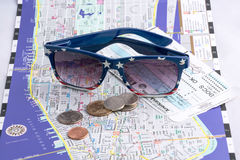Sunglasses, plane tickets, map and U.S. coins. Stock Images